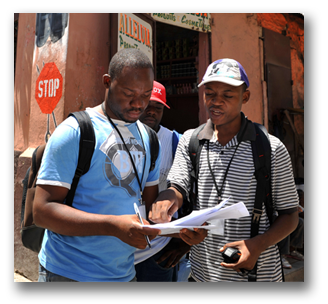 Men looking at a guide for directions
