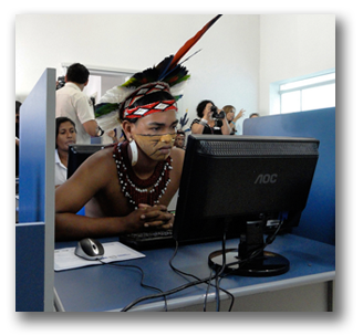 Indigenous man sitting at a computer