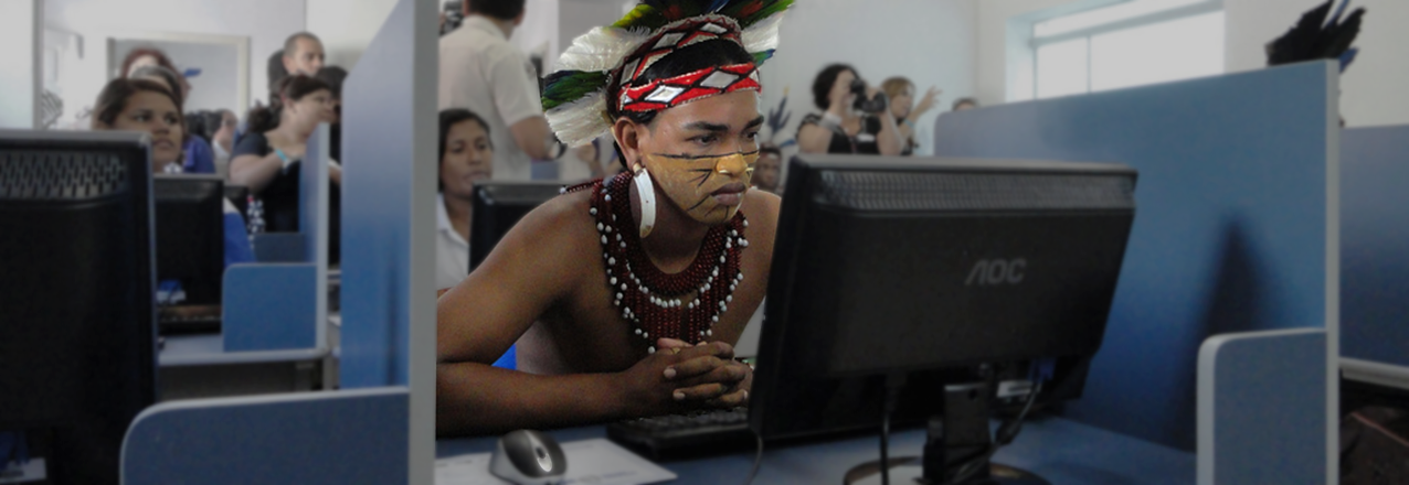 A young Brazilian man checks out the new computer center in the city of Cabrália, Brazil