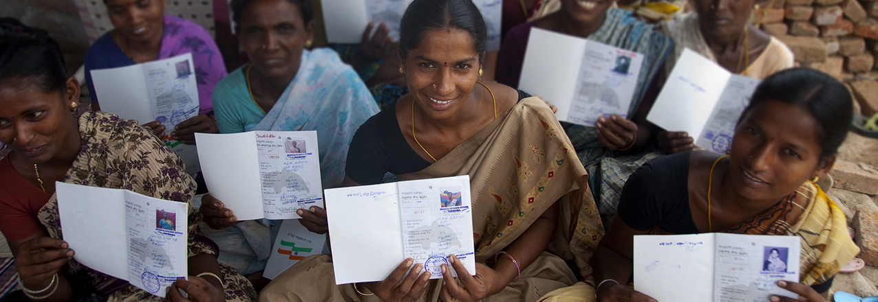 Indian women holding land titles