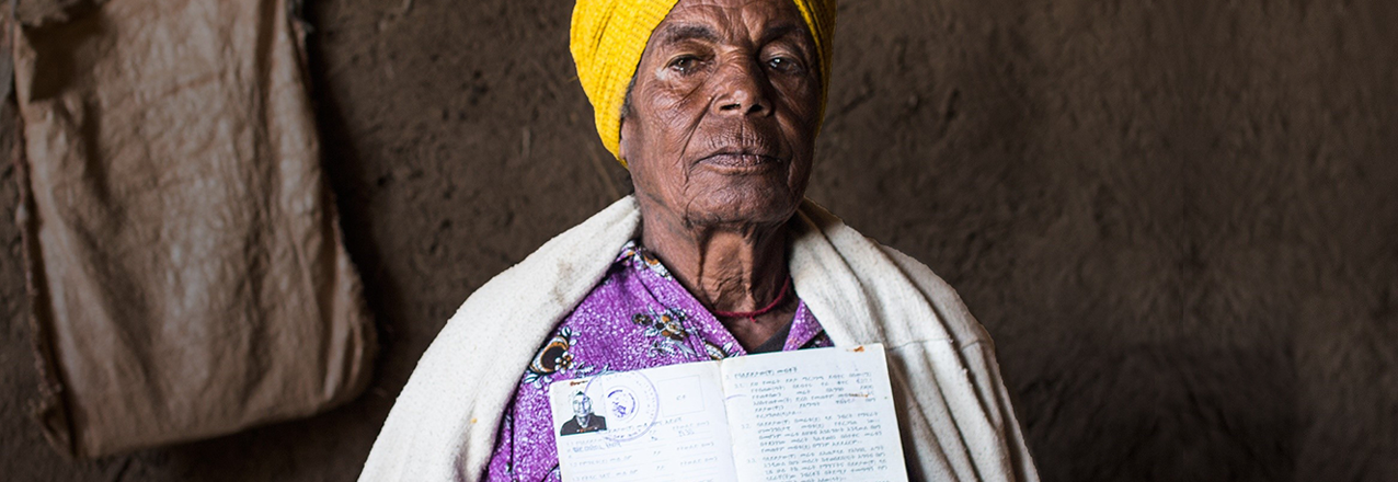 Ethiopian woman holding a land certificate
