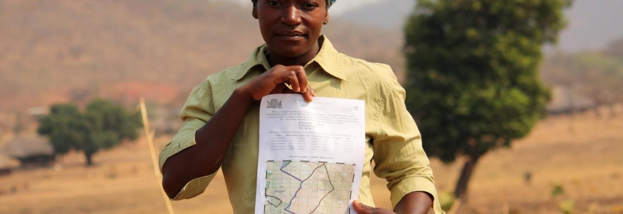 woman with land title