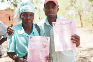 man and woman holding documents